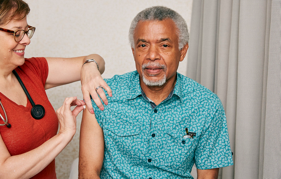 older man gets vaccinated